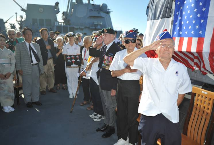 Hiro Endo, Yasunori Deguchi and Albert Brum, all 100th Battalion World War II veterans, give honors during the U.S. national anthem. During the ceremony, Rear Adm. Anne Cullere, commander in chief of French forces in the Pacific, presented the French Nation Order of the Legion of Honor aboard the French Flor�al-class frigate FS Prairial (F731). For more than a decade the government of France has presented the Legion of Honor to U.S. veterans who participated in the liberation of France during World War II. The ceremony took place during Rim of the Pacific, the world's largest international maritime exercise. (U.S. Navy Photo by Mass Communication Specialist 1st Class David Kolmel)