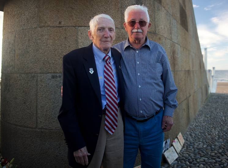 "James ""Pee Wee"" Martin, left, poses for a photo with Erich Bessoir June 7, 2014, at Omaha Beach, in Normandy, France. Martin met Bessoir, a German World War II veteran of the Waffen-SS, to promote understanding of former enemies and progressing international friendships during the celebration of the 70th Anniversary of D-Day. (Photo by USAF Senior Airman Alexander W. Riedel)"