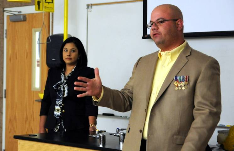 Retired Army Sgt. 1st Class Victor Medina, right, addresses a class of future nurses about what it is like to live with a traumatic brain injury at El Paso Community College, Northwest Campus, El Paso, Texas, March 6, 2014. Medina and his wife, Roxana Delgado, left, share their story with future health care providers to give them an understanding of TBI other than what textbooks teach. (U.S. Army photo by Staff Sgt. Candice Harrison)