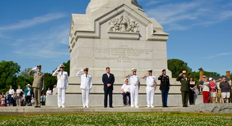 YORKTOWN, Va. (June 2, 2014) American and French naval officers render a salute to the French navy frigate La Fayette (F710) following the ship's 21-gun salute during a wreath-laying ceremony at the Yorktown Victory Monument. The ceremony commemorated the joint U.S. and French victory over the British army at Yorktown in 1781, and to honor the continued alliance between France and America. (U.S. Navy photo by Mass Communication Specialist Seaman Adam Austin)