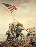 Five Marines and a Navy corpsman raising the American flag over Mt. Suribachi on Iwo Jima.