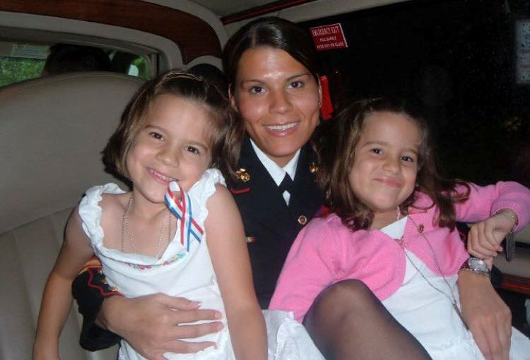 Twin sisters Laura and Adriana Cole with their mom, Gina Pompeyo, in her Marine Corps uniform when they were little girls. (Photo courtesy by Gina Pompeyo)