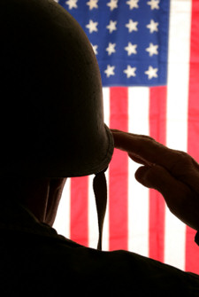 An American military service member saluting Old Glory