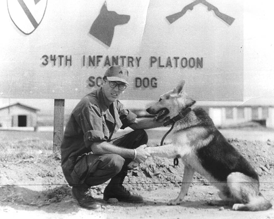 U.S. Army Jerry Shirley, with his scout dog, Jack, in front of their unit, the 34th Infantry Platoon (Scout Dog), 1st Cavalry Division, in Vietnam in 1969. (Photo courtesy of Jerry Shirley)