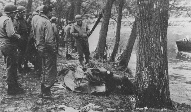 A photograph of the remaining parts of the B-17 Flying Fortress fuselage, manned by 1st Lt. Cuno Vernal Becker, and his crew, taken along the banks of the Ambleve River near Aywaille, Belgium, after the aircraft was shot down, Dec. 24, 1944. (Courtesy Photo)