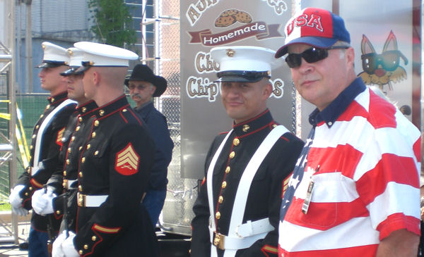 David Bancroft, founder of USA Patriotism!, with Marine Honor Guard at the Salute to Our Troops' celebration
