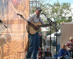 Marine veteran Chad Van Rys performing for troops at the Salute to Our Troops' celebration